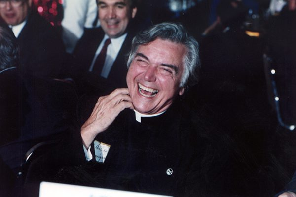 Father Cunningham laughing